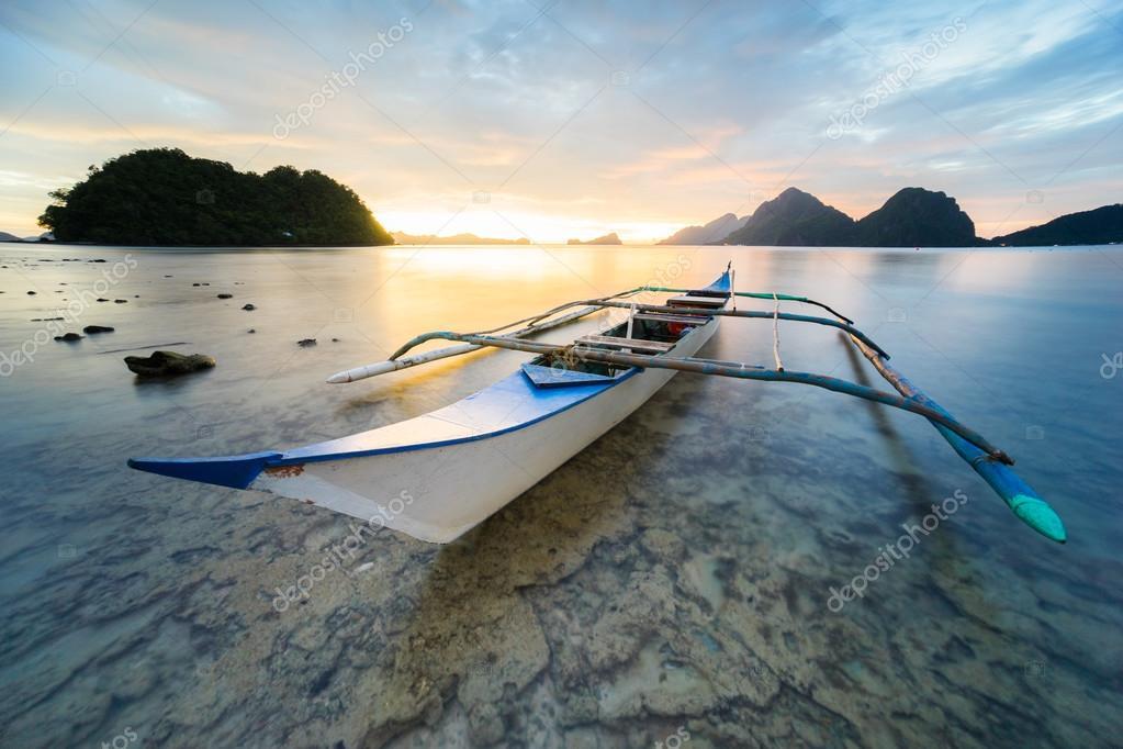 Boat docked during beautiful sunset