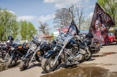 Black chrome Harley Davidson motorcycles and other sports motorcycles in the parking lot of members of the biker club of Ukraine, Lviv