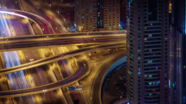 dubai city night illumination traffic crossroad junction 4k time lapse united arab emirates