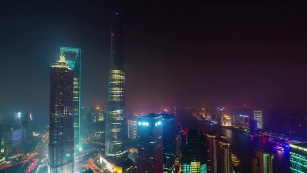 éjszakai shanghai city belvárosi épületek tető felső panoráma 4k idő telik el Kína