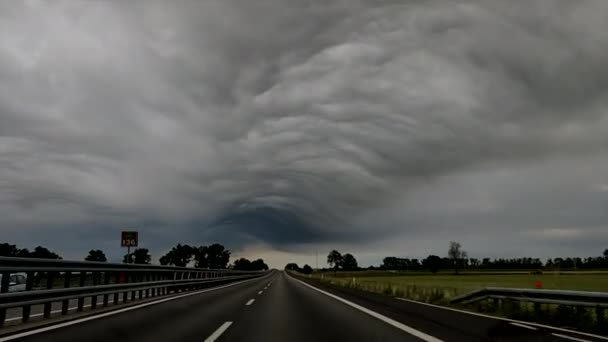 highway in Italy, super cell of bad weather storm hail wind and slush