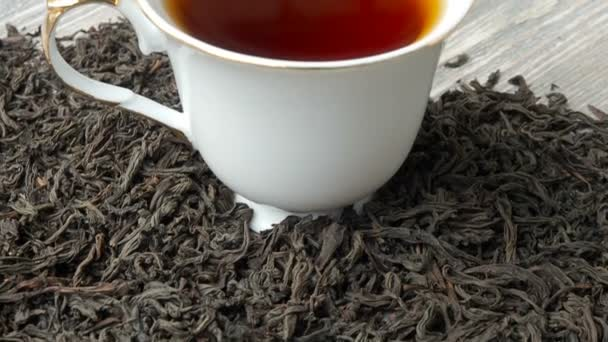 White cup of hot black tea, close up