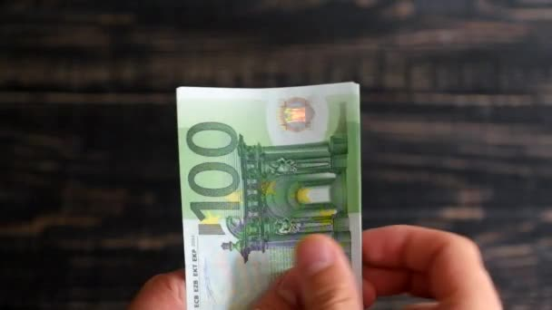 Hands count 500 euros