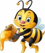 Fotografia Ape del fumetto che tiene benna con miele gocciolante