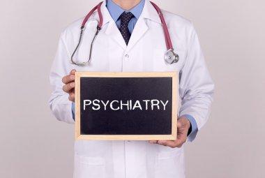 Doctor holding mini blackboard