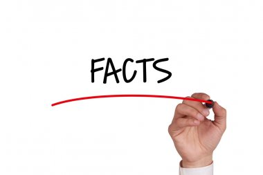 Hand writing facts with black marker