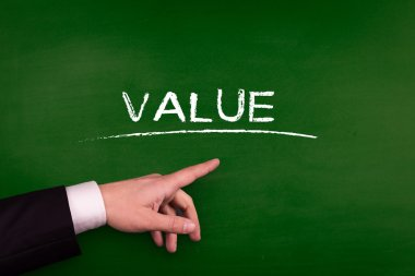 Businessman pointing on value