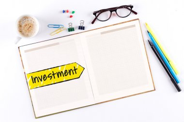 Investment text on notebook