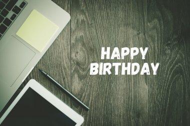 HAPPY BIRTHDAY text on desk