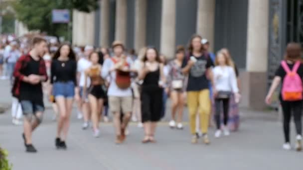 People walking on the street, not in focus