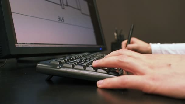 Tablet 31. Close up of the hand of a engineer editing scheme in CAD system, signed dimension on LCD monitor, holding an electronic stylus.