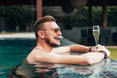 successful man has a rest in the pool