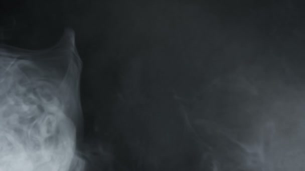 Smoke abstract. Smoke cloud. White smoke on black background. Cigarette smoke