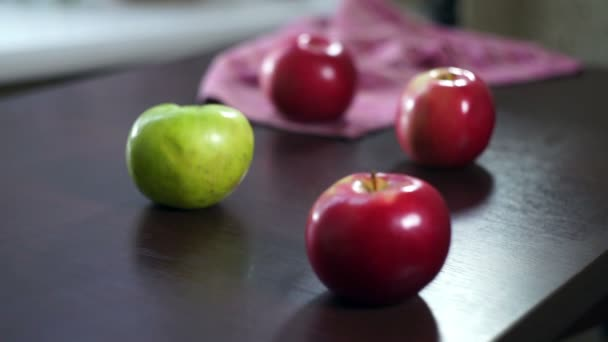 Fresh apples on wooden table. Red and green apples. Fruits on table