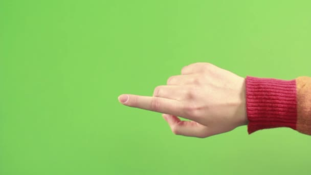 Isolated right hand on green background make gesture. Green screen studio