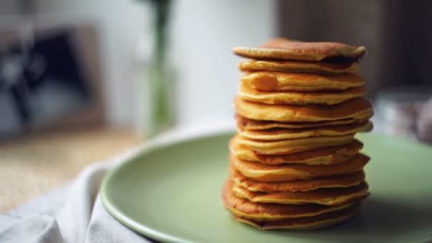 Dessert for morning breakfast. Man takes pancake from pancake stack