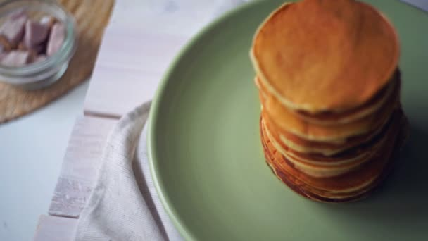 American pancakes on plate. High stack of pancakes baked for morning breakfast