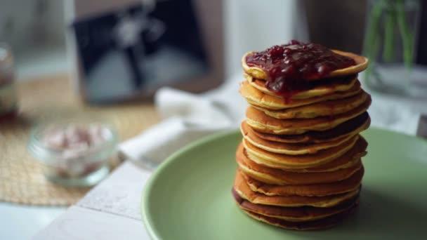 Jam on pancakes. Strawberry jam on stack of golden pancake. Sweet breakfast
