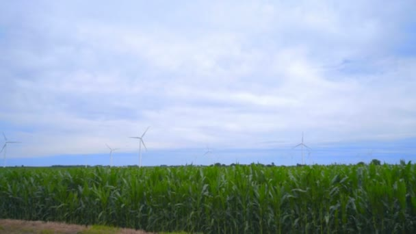 Wind turbine farm on green field. Wind turbines against clouds sky