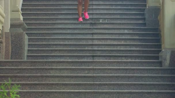 Woman running down stairs in slow motion. Running woman on staircase