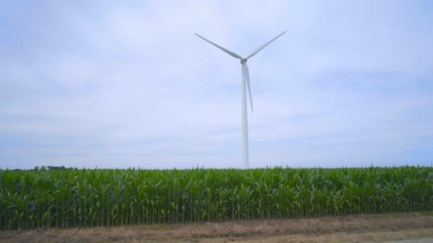 Wind power generator on green field. Green energy source