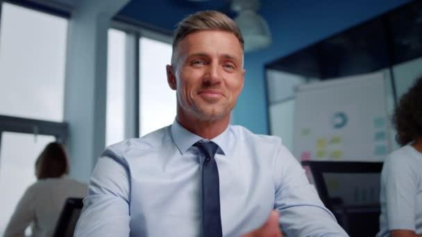 Businessman having online video conference. Entrepreneur showing thumb up