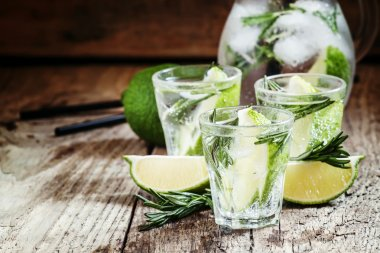 Drink with lime, rosemary, honey and soda, pitcher with crushed ice