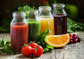 Fotografie Bottles with fresh juices from fruits and vegetables