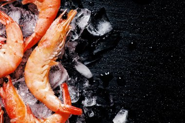 Food background, frozen cooked shrimps with ice