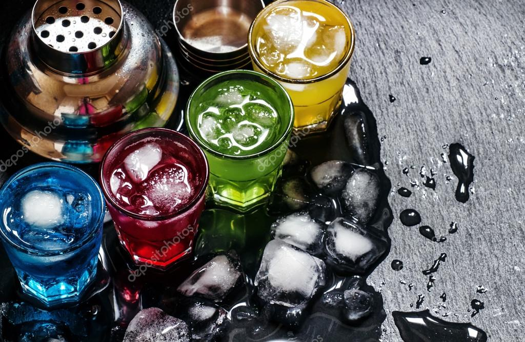 Cocktails with ice on a dark background