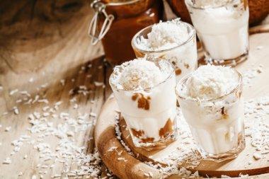 Coconut dessert with vanilla ice cream and caramel