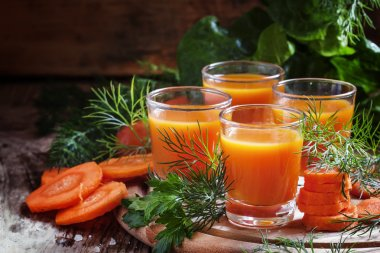 Freshly squeezed carrot juice in glasses