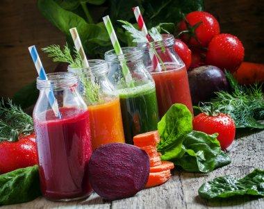 Freshly squeezed vegetable juice in bottles