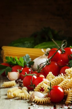 Dry pasta fusilli with tomatoes