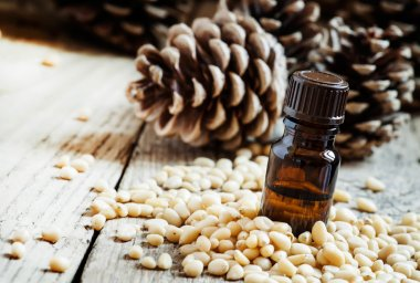 Essential oil of cedar in a small brown bottle