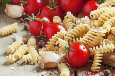 Dry Italian pasta spiraline with cherry tomatoes