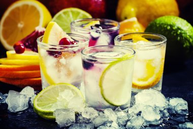 Chilled soft drinks with ice, citrus fruits and berries