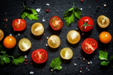 Food background: red, yellow and orange cherry tomatoes
