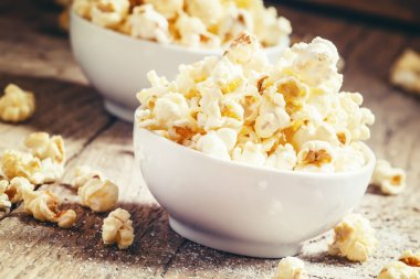 Sweet popcorn in white bowls