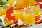 Fotografie Citrus juice from oranges, tangerines, grapefruits, lemons, apples, pomelo