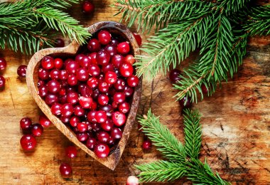 Fresh cranberries in heart shaped bowl