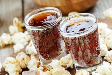 Caramel popcorn and cola in a glasses