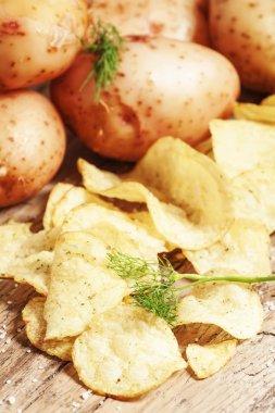 Fresh potatoes and potato chips