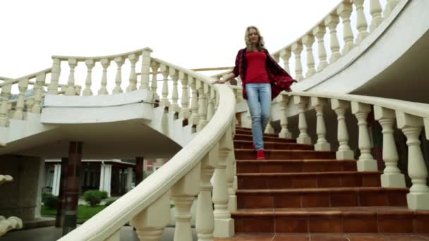 Woman down the stairs. Girl and ladder. Marble staircase. Democratic style. graceful gait. beautiful staircase. cozy courtyard.