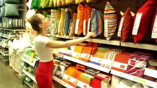 IKEA. Russia, Krasnodar 28/05/2016. Woman in a supermarket. The girl in the shop. Buyer. Trade. Shopping center. Choose  pillow. Buy cushion. Textile shop