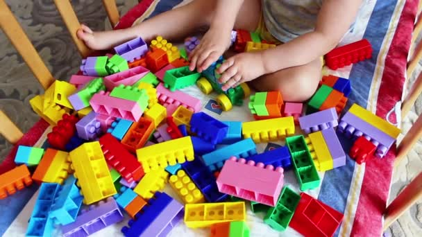 Child playing with colorful plastic blocks.