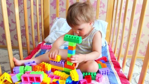 Kid building car with bricks.