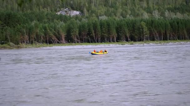 people rafting on a mountain river