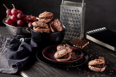 Organic almond cookies on dark wooden background