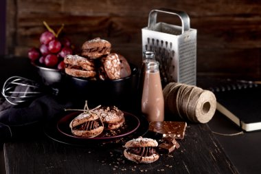 Maroni italian cookies and chocolate milkshakes on dark wooden b